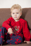 Boy in pyjama on sofa Royalty Free Stock Image