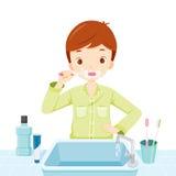 Boy In Pyjamas Brushing His Teeth In Bathroom Stock Images