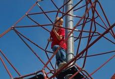 Boy on pyramid net climber Stock Image
