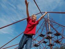 Boy on pyramid net climber Stock Photo