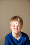 Boy with question mark Stock Photo