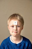 Boy with question mark Royalty Free Stock Photos