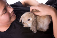 Boy and rabbit. Young teenager boy holding a seven weeks old rabbit Royalty Free Stock Photo