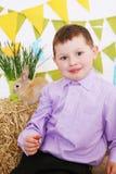 Boy  and rabbit Stock Photo