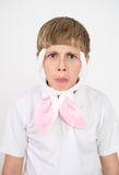 Boy with rabbit ears makes faces. Boy with rabbit ears makes disappointed and sad faces Stock Photography