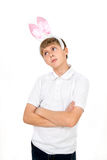 Boy with rabbit ears makes faces Royalty Free Stock Image
