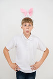 Boy with rabbit ears makes surprised faces. Boy with rabbit ears makes surprised or teasing faces Stock Photo