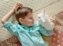 Boy and rabbit Stock Image