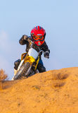 Boy racer on a motorcycle in the desert Royalty Free Stock Photo