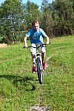 Boy racing with his bike in open Royalty Free Stock Photography
