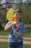 Boy with racket Royalty Free Stock Image