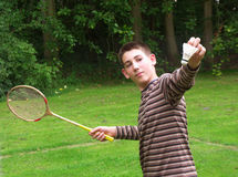 Boy with racket. A kid plaing badminton outdoors Royalty Free Stock Images
