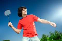 Boy with racket on blue background Stock Images