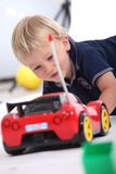 Boy with radio controlled car Royalty Free Stock Photos