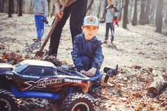 Boy with radio-controlled models in nature, hobbies and leisure. Kiev, Ukraine - APRIL, 2018 : boy with radio-controlled models in nature, hobbies and leisure Stock Photos