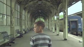 Boy On The Rail Station stock footage
