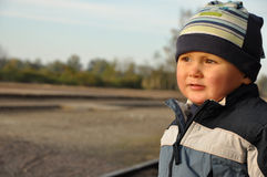 Boy at railway station Royalty Free Stock Photo