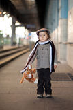 Boy on a railway station stock photo