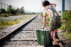 Boy at the railway station waiting the train Stock Photography