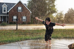 Boy in the Rain Stock Images