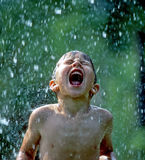 Boy Catching Rain In His Mouth Royalty Free Stock Photos
