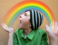 Boy with Rainbow. Happy boy imagines his little Rainbow Stock Photography