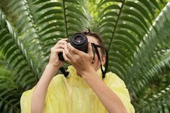 Boy In Raincoat Taking Photos In Forest Royalty Free Stock Photo