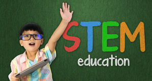 Boy raise his hand up for STEM education. Boy holding tablet raise his hand up for STEM education Stock Photos