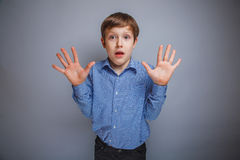 Boy raised his hands,  palms outward Stock Images
