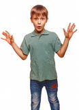 Boy raised his hands up baby teenager surprised Stock Image