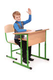 Boy raising hand to ask question Royalty Free Stock Photo