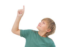 Boy raising his finger and looking up Stock Photo