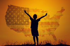 Boy raising his hands standing during sun set Stock Photo