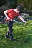 Boy raking up grass Royalty Free Stock Photo