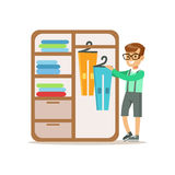 Boy Ranging Clothes In Dresser Smiling Cartoon Kid Character Helping With Housekeeping And Doing House Cleanup Royalty Free Stock Photo