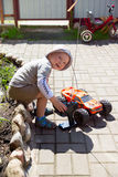 Boy and rc car Stock Image
