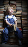 Boy reach for a book Royalty Free Stock Photography