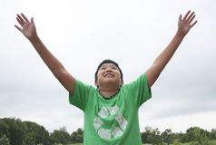 Boy Reaching for the Skies Stock Photography