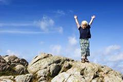 Boy reaching top stock photo