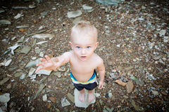 Boy Reaching Up With Hand Outstreched Royalty Free Stock Photo