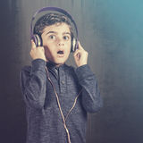 Boy reacts while listening to music Royalty Free Stock Image