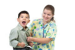 Boy reacts to cold stethoscope. Stock Photo