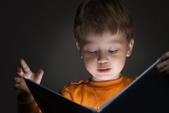 Boy read book. Little boy read interesting book royalty free stock photos