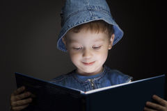 Boy read book Stock Image