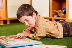 Boy reading Royalty Free Stock Photo