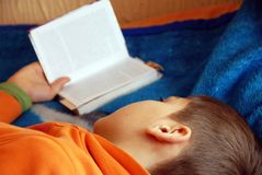 Free Boy Reading Stock Photos - 18636743