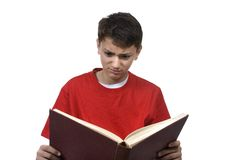 Boy Reading. A young boy is reading a book. Isolated on white Stock Photos