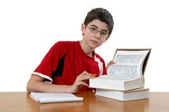 Boy reading. The young boy does the home work Stock Photography