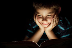 Boy reading bedtime story Stock Images