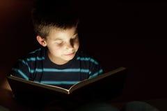 Boy reading bedtime story stock photography